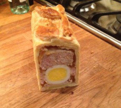 An oblong pie, with hard-boiled egg garnish.