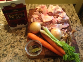 Clockwise, from 12 o'clock: uncooked chicken + any scraps from cooked chicken you might have; celery, onions, carrots, bay leaves, thyme, parsley (not shown), peppercorns, and salt.